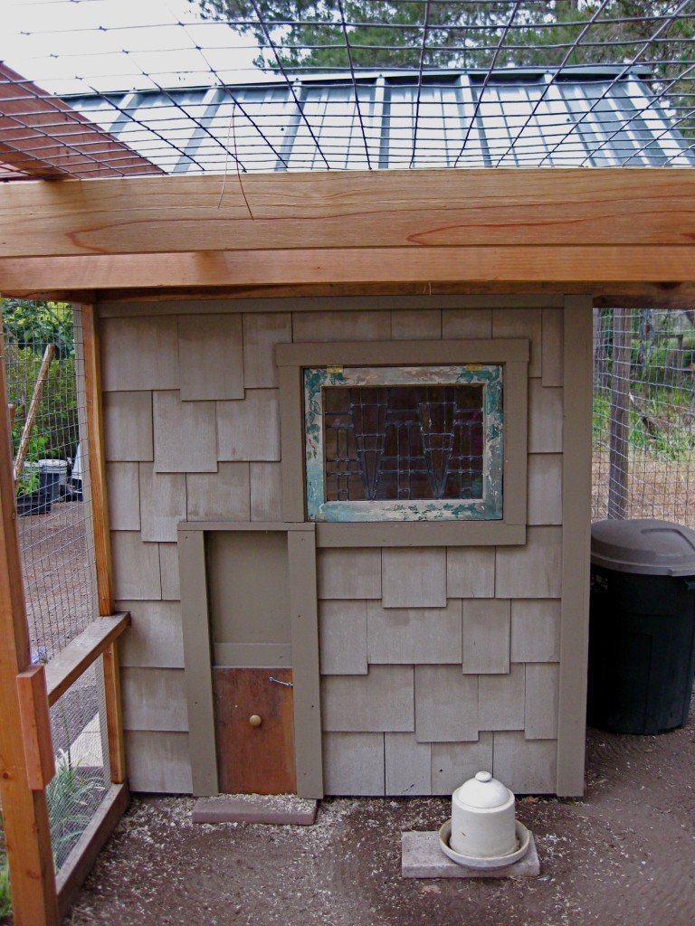 Sliding door on chicken coop